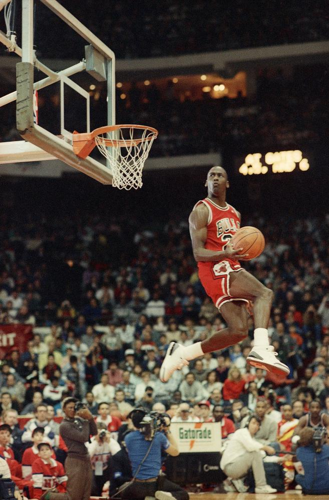 Michael Jordan dunks the ball during the slam-dunk championship in Chicago 1988 as a part of the NBA All-Star weekend.