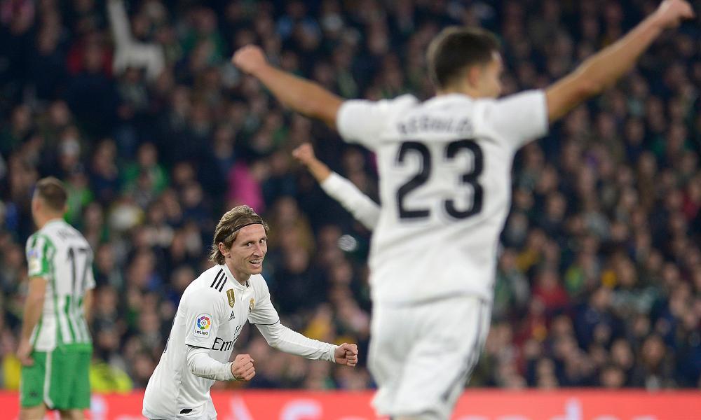 Luka Modric wheels away after scoring.