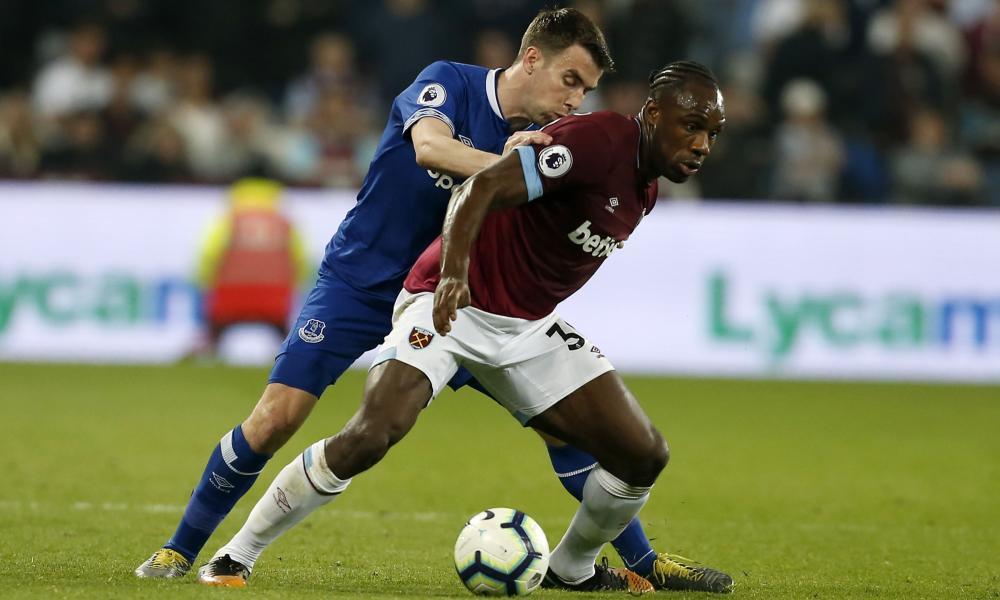Everton's Seamus Coleman (left) challenges West Ham United's Michail Antonio.