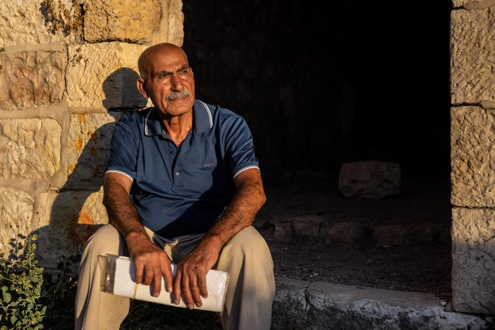 Yacoub Odeh, an 81-year-old who grew up in Lifta, sits outside what was once the village's mosque.
