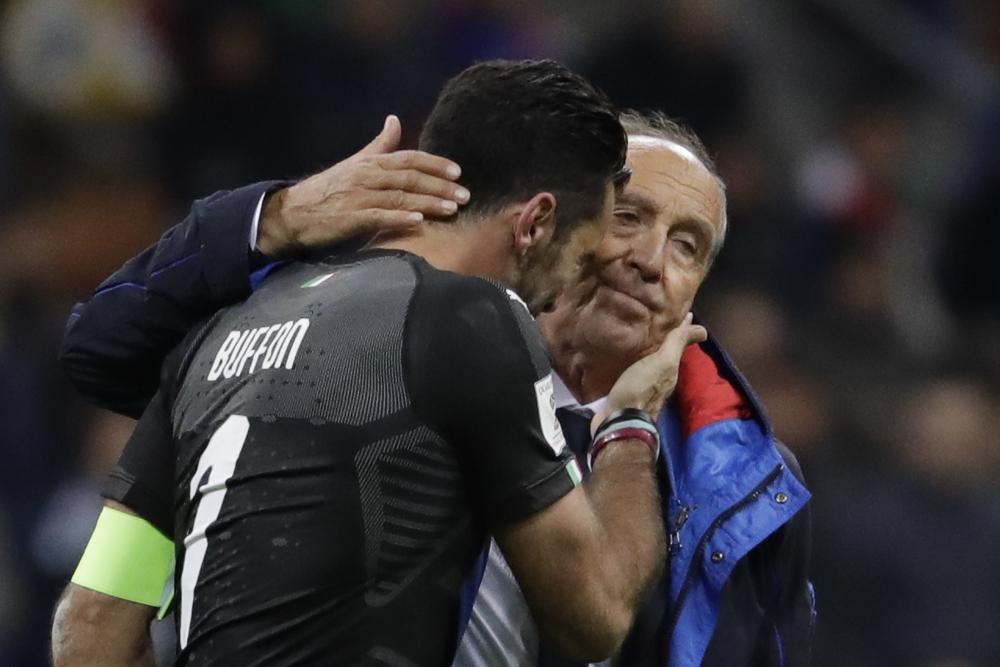 Gianluigi Buffon is comforted by manager Gian Piero Ventura.