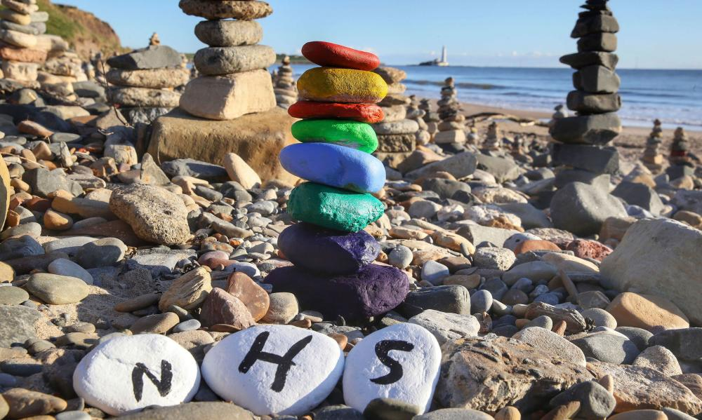 A pebble stack at Whitely Bay this morning in recognition of the NHS, which has been added to hundreds of others on the beach.