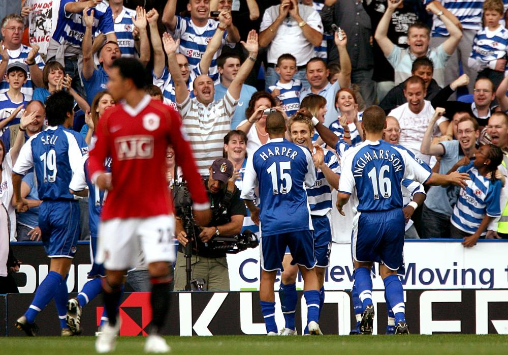 Kevin Doyle celebrates with the Reading fans.