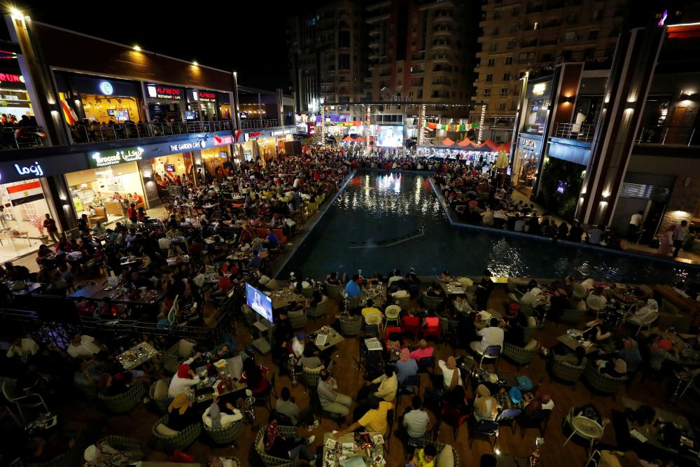 Egypt fans watch the game on a big screen in Cairo.