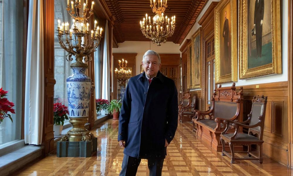 Mexico's President Andrés Manuel López Obrador smiles as he broadcasts a message saying he passed the critical phase of infection at the National Palace in Mexico City on 29 January