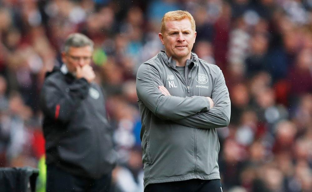 Neil Lennon looks on with Craig Levein behind him.