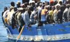 A boat with immigrants on board arrives on the Italian island of Lampedusa, southern Italy, on 09 April 2011.