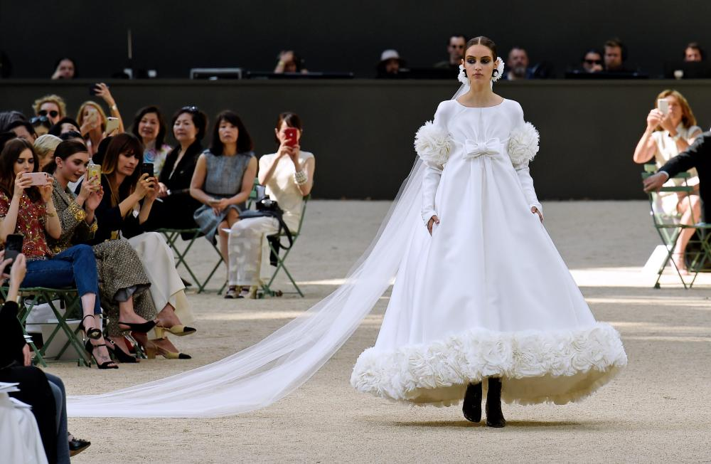 Cream and white, Chanel's take on the classic bridal gown.