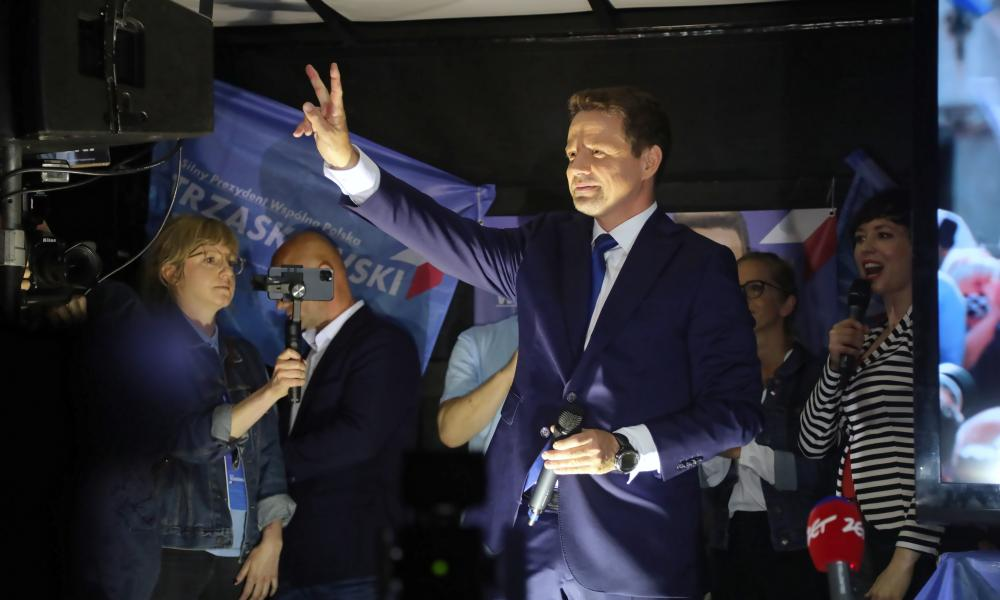 Trzaskowski waves to supporters before an election debate