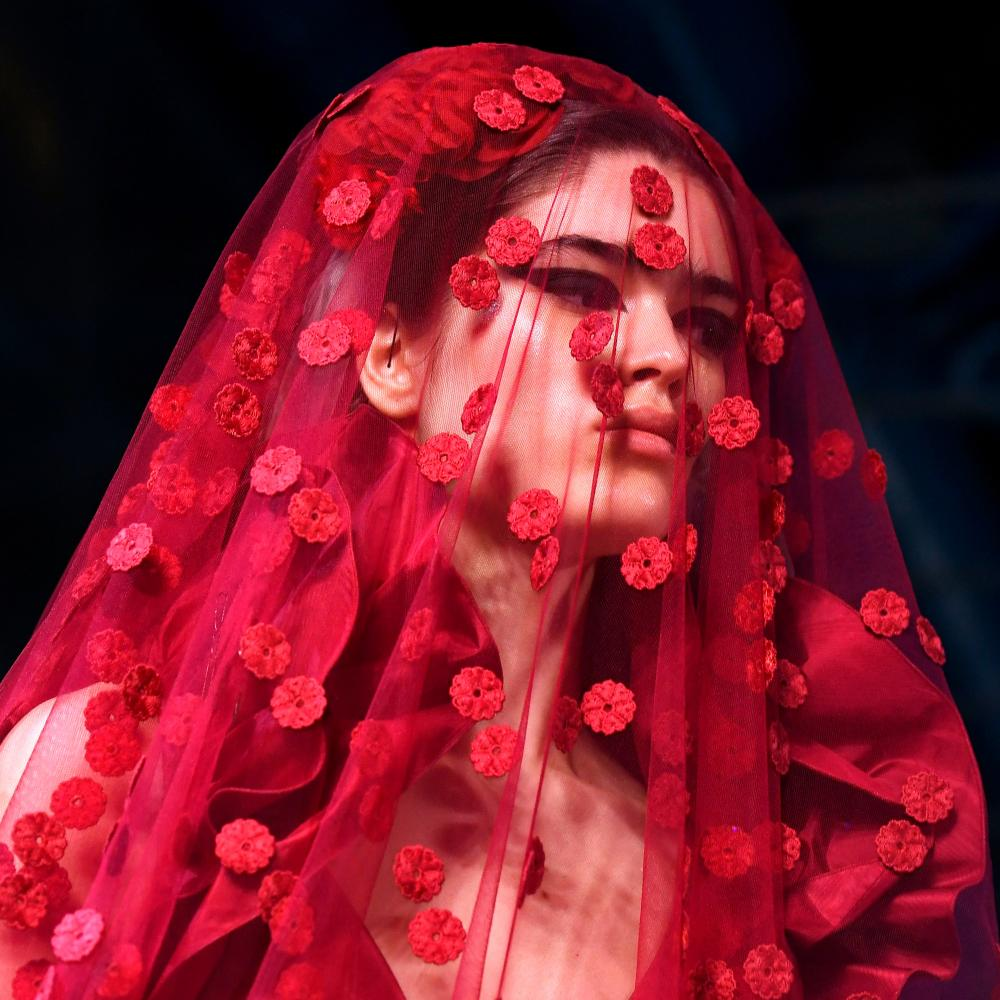 An embroidered red veil