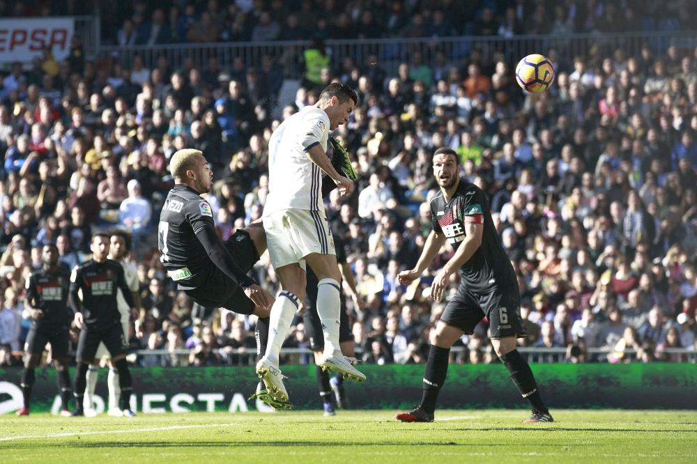 Cristiano Ronaldo heads home the third.