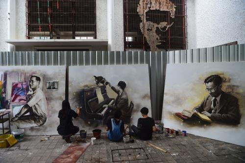 Students at Silpakorn University in Bangkok, Thailand, paint portraits of the late King Bhumibol Adulyadej