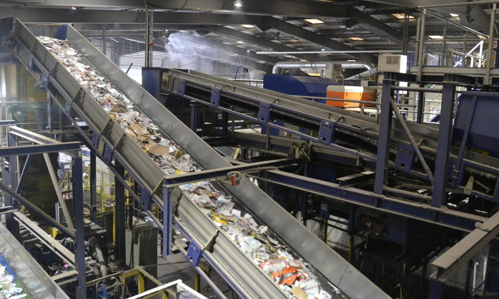 A materials recovery facility in Milton Keynes where waste is sorted. In the UK, there are 28 different recycling labels that can appear on packaging