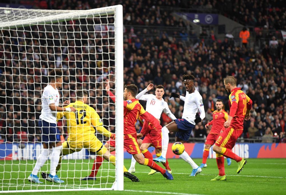 Montenegro's Aleksandar Sofranac scores an own goal.