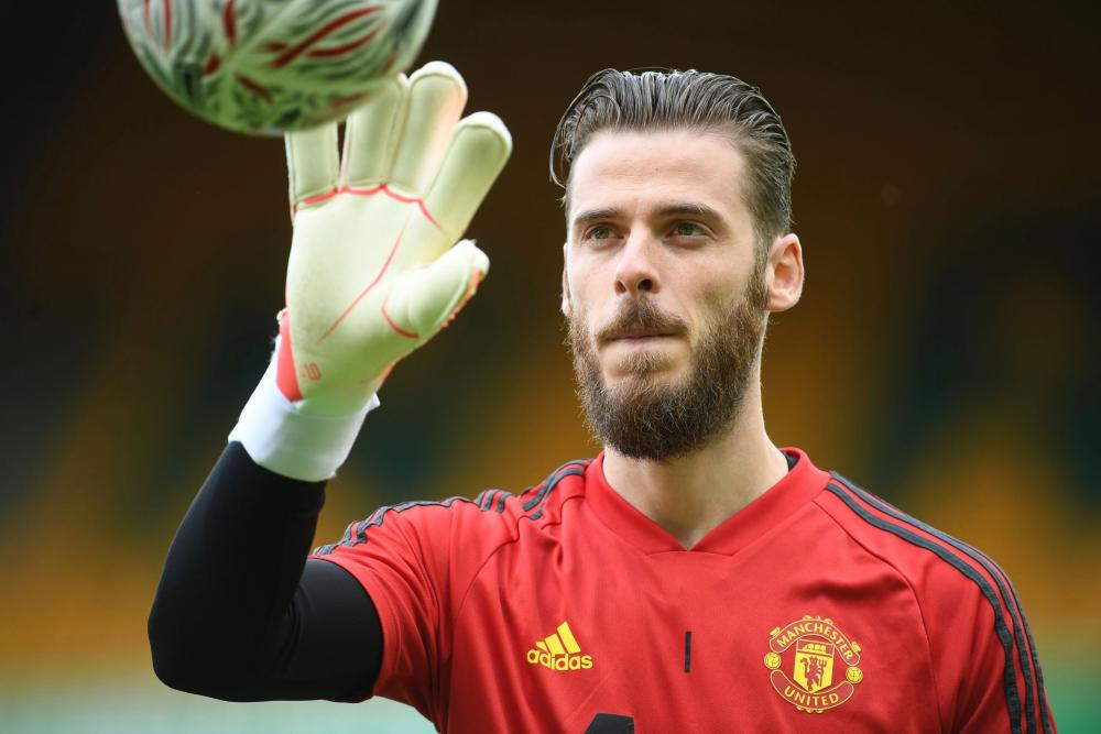 David de Gea warms up before taking his place as a substitute today.
