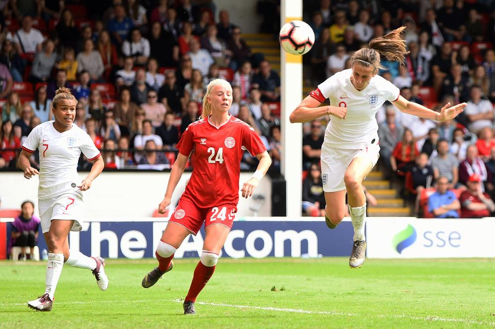 Jill Scott of England scores her team's second goal