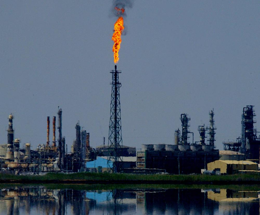 View of the Shuaiba oil refinery 28 March 2004. Iraq is facing difficulties in exporting oil from both its northern and southern fields, the Middle East Economic Survey reports in its edition dated 27 March 2004. AFP PHOTO Antonio SCORZA (Photo credit should read ANTONIO SCORZA/AFP/Getty Images)