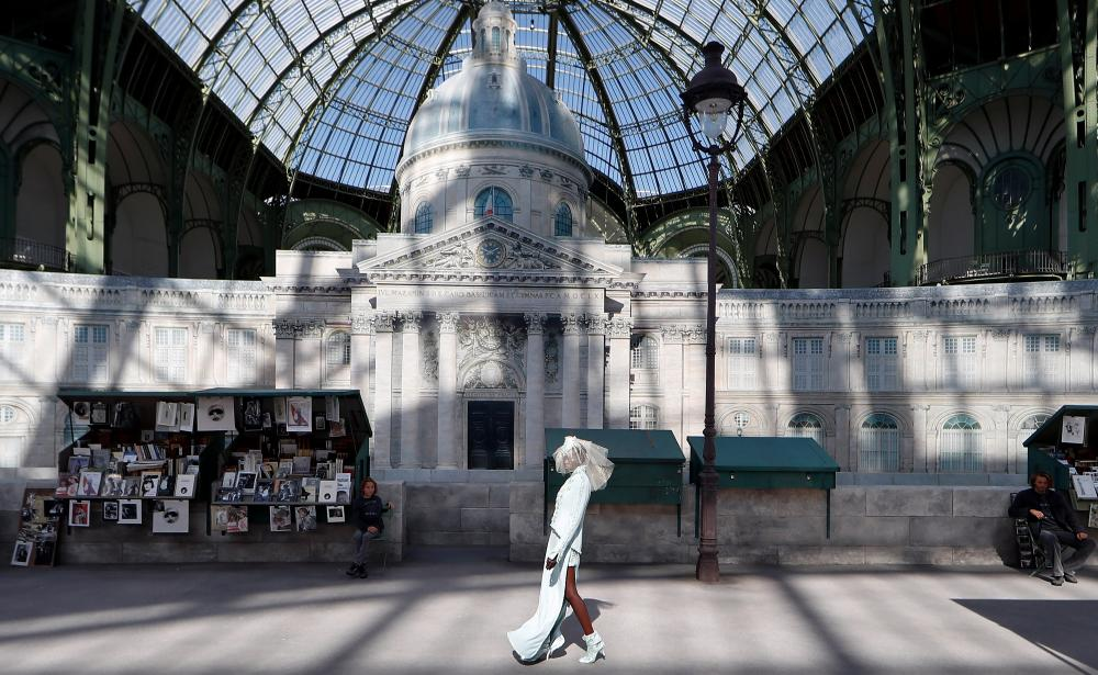 Chanel's extravagant setting for the show included street lamps along a promenade.