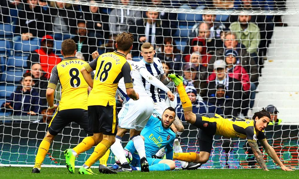 Arsenal goalkeeper David Ospina spills the ball to allow Hal Robson-Kanu of West Bromwich Albion to score