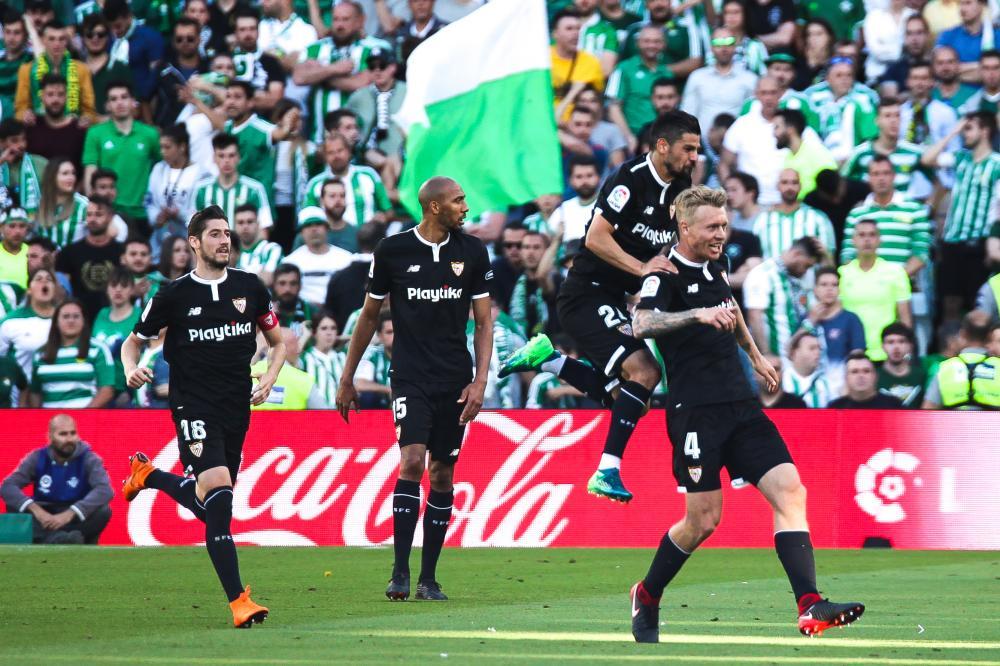 Sevilla players celebrate Simon Kjaer's goal.