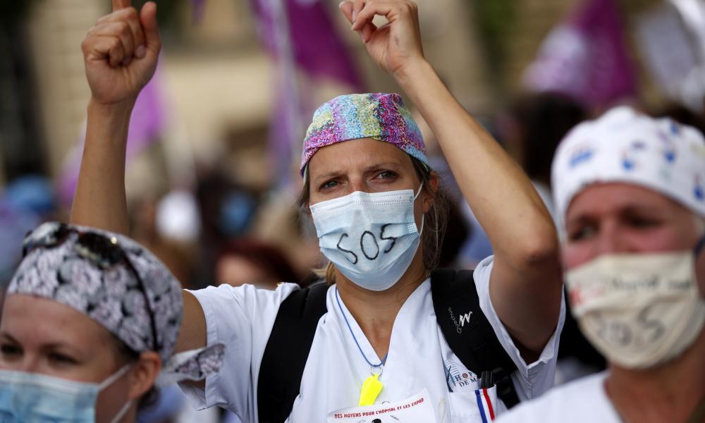 A hospital worker participates in a protest against government policies and to demand better employment conditions in Paris, France.