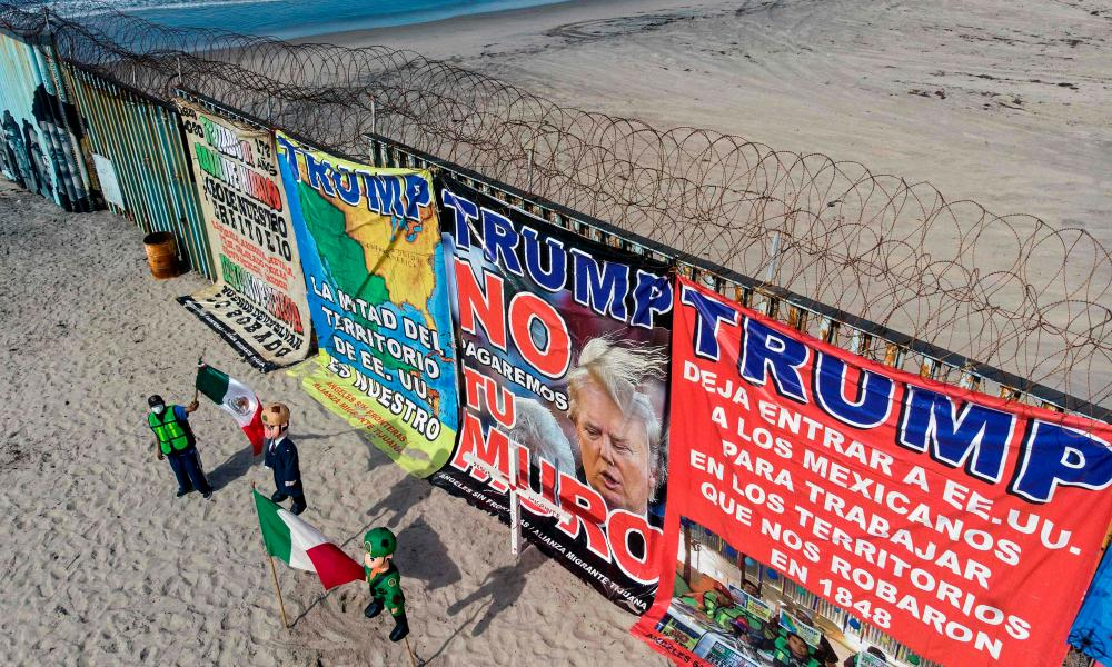 Aerial view of demonstrators preparing to burn a pinata depicting US president Donald Trump.