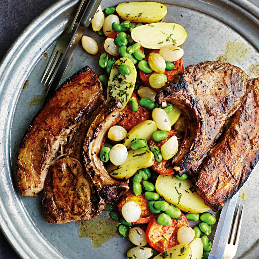Pork chops with tomato, sage and broad beans.