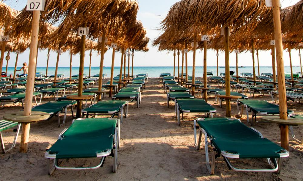 Umbrellas and sunbeds on Elafonissi beach, Crete, Greece.