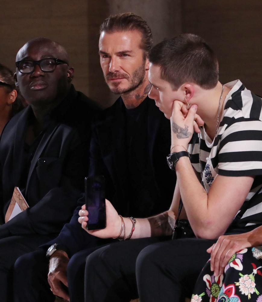 Edward Enninful, David Beckham and Brooklyn Beckham in the front row