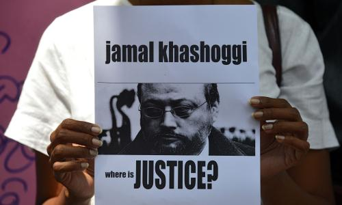"A members of the Sri Lankan web journalist association holds a placard with the image of Saudi journalist Jamal Khashoggi during a demonstration outside the Saudi Embassy in Colombo on October 25, 2018, following Khashoggi's dissapearance on October 2 at the Saudi consulate in Istanbul. - Saudi Arabia's crown prince denounced the ""repulsive"" murder of journalist Jamal Khashoggi and vowed justice will prevail, in his first public comments on the case, without addressing US accusations of a monumental cover-up. (Photo by LAKRUWAN WANNIARACHCHI / AFP)LAKRUWAN WANNIARACHCHI/AFP/Getty Images"