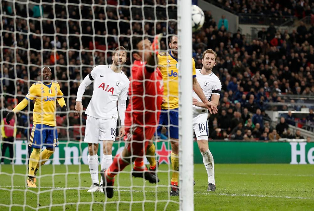 Harry Kane's header beats Gianluigi Buffon only to rebound off the post and away from danger.