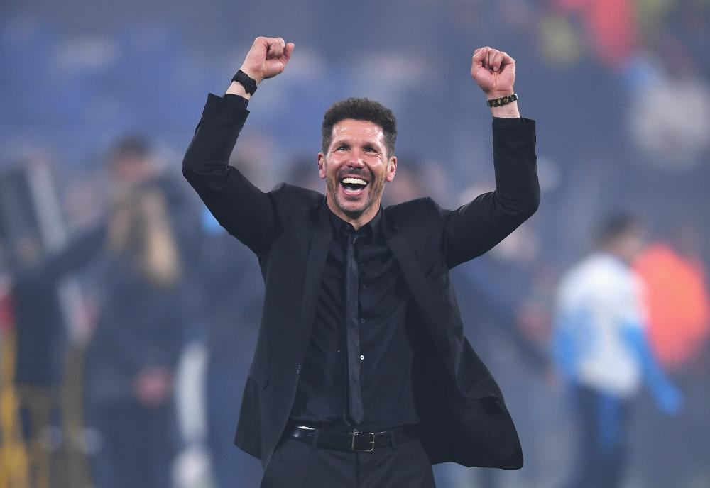 Atletico Madrid coach Diego Simeone celebrates his team's victory in the UEFA Europa League Final.