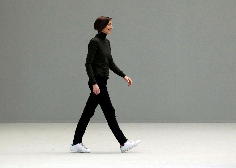Phoebe Philo bows after the AW11/12 Céline show, wearing (as ever) her famous Stan Smiths.