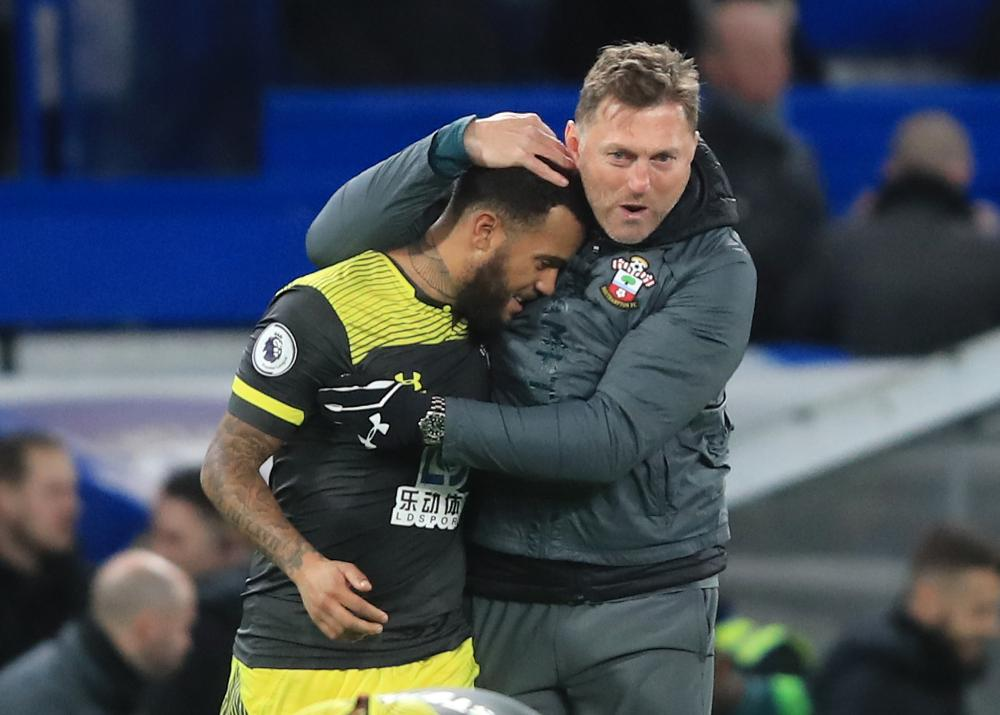 Ralph Hasenhüttl celebrates Southampton's Boxing Day win at Chelsea with Ryan Bertrand.