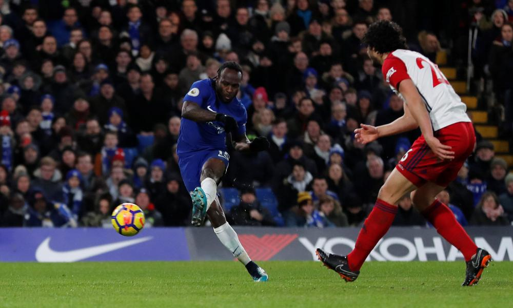 Victor Moses slots in the second after a fortunate deflection off Dawson.
