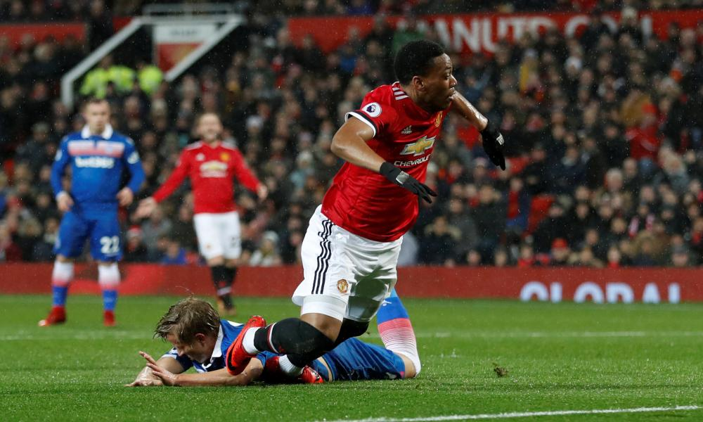 Anthony Martial goes down in the area after a challenge by Moritz Bauer