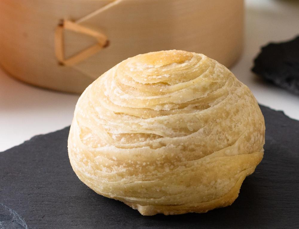 A Teochew or thousand-layer mooncake, with a laminate pastry crust.