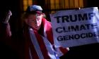 A man wearing a mask depicting U.S. President-Elect Donald Trump protests during a demonstration against climate change outside of the U.S. Embassy in London, Britain on November 18, 2016. REUTERS/Hannah McKay/File Photo