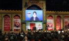 FILE PHOTO: Lebanon's Hezbollah leader Sayyed Hassan Nasrallah addresses his supporters via a screen during a funeral ceremony rally to mourn Qassem Soleimani, head of the elite Quds Force, who was killed in an air strike at Baghdad airport, in Beirut's suburbs, Lebanon, January 5, 2020. REUTERS/Aziz Taher/File Photo
