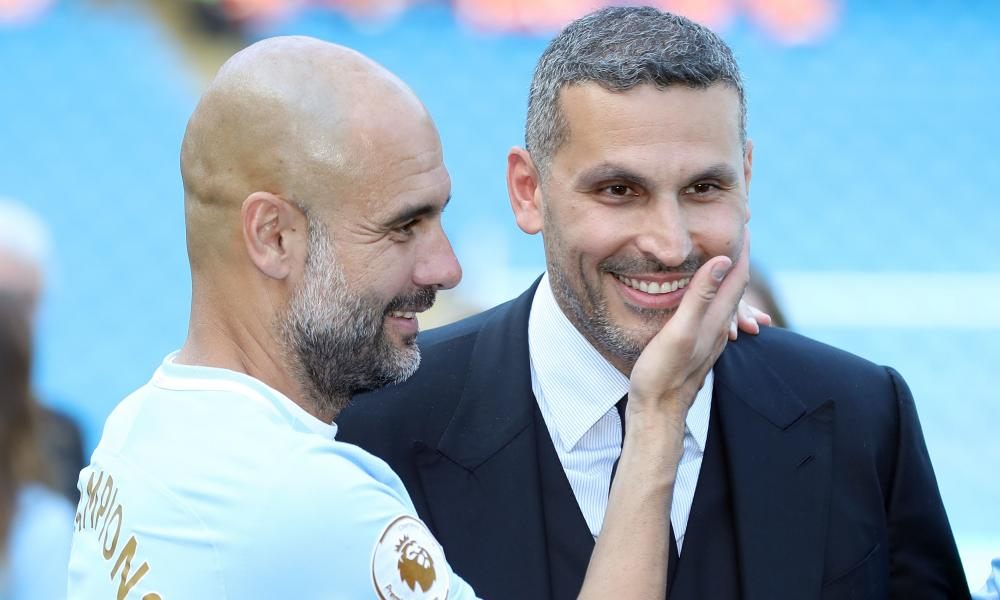 Pep Guardiola with Khaldoon al-Mubarak, who sees FFP as a restraint of Sheikh Mansour's freedom to rebuild City by pouring money in.