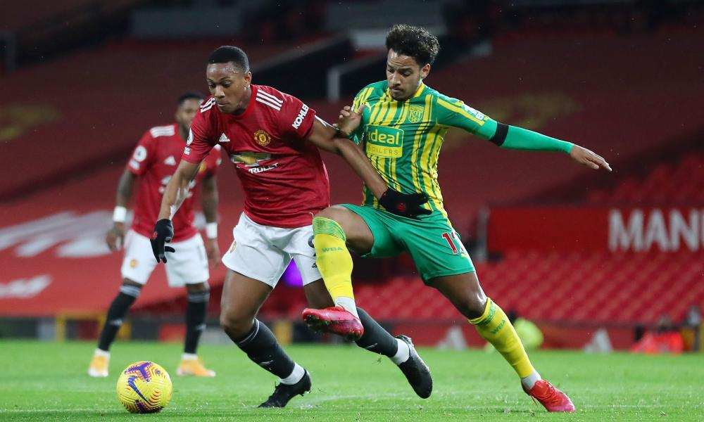 Anthony Martial of Manchester United battles for possession with Matheus Pereira of West Bromwich Albion.