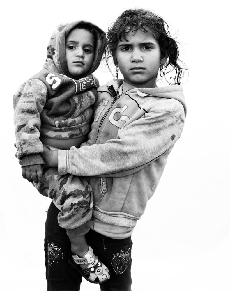 Lamis, five, from Homs, Syria, with her one-year-old brother Jad – a portrait taken in 2016 in Bekaa Valley, Lebanon.