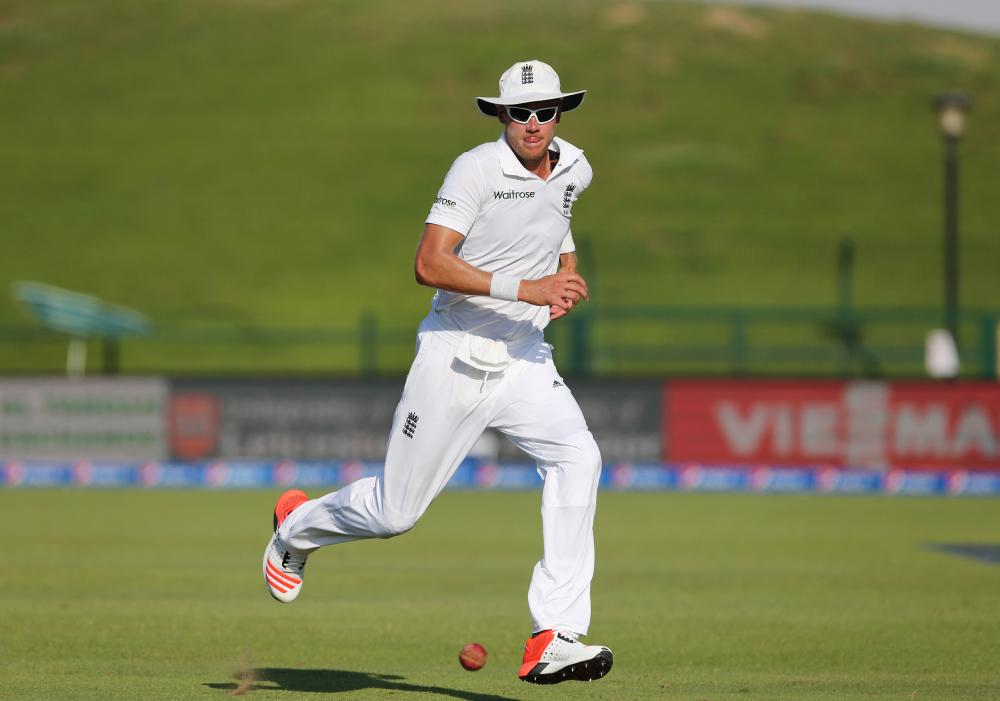 England's Stuart Broad gives chase to the ball.