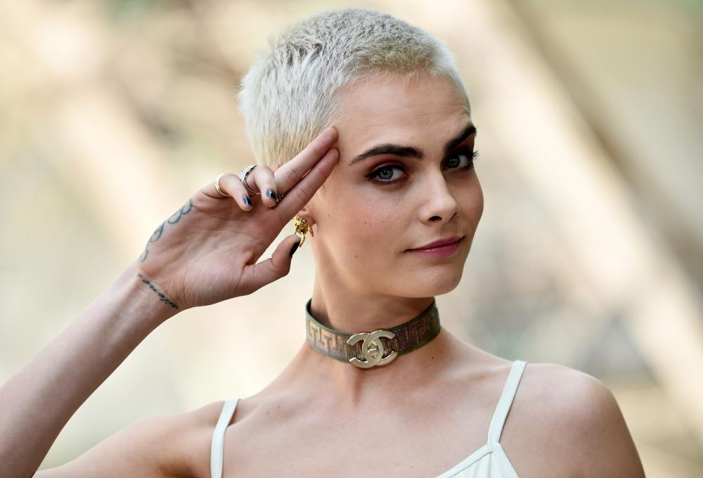 Cara Delevingne, in Chanel, showcasing her new buzzcut.