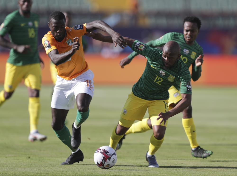 South Africa's Percy Tau, left, and Ivory Coast's Wilfried Bony fight for the ball.