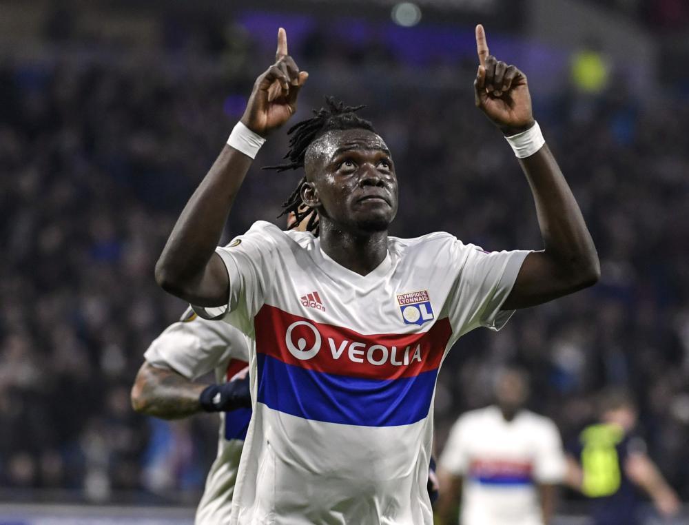 Lyon's Bertrand Traore celebrates after opening the scoring.