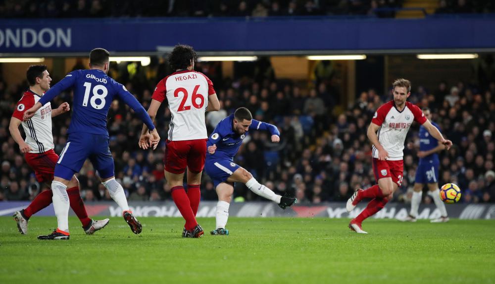 Eden Hazard fires in the opening goal after a smart assist from Giroud.