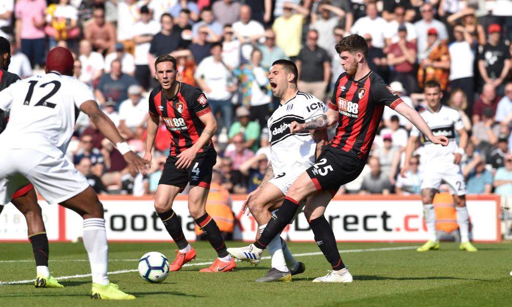 Alexandar Mitrovic of Fulham is fouled by Jack Simpson of Bournemouth for a penalty.