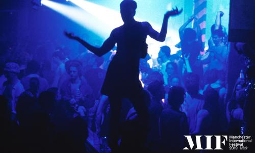 Silhouette of a clubber dancing at the Hacienda nightclub in Manchester