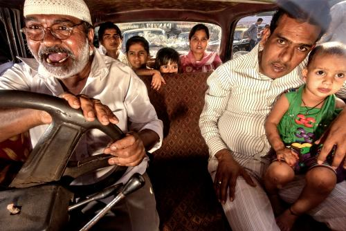 An Indian family in a Mumbai taxi